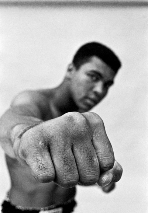 USA. Chicago 1966. Muhammad Ali, boxing world heavy weight champion showing off his right fist. © Thomas Hoepker / Magnum Photos